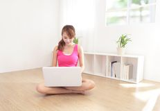 Young beautiful girl with a laptop at home Stock Images