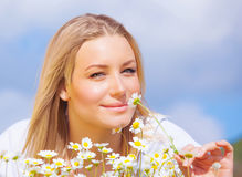 Beautiful girl enjoying daisy field Royalty Free Stock Photography