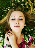 Young beautiful girl lays on a grass Royalty Free Stock Photo