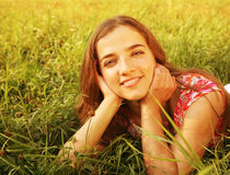 Young beautiful girl lays on a grass Royalty Free Stock Photos