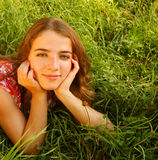 Young beautiful girl lays on a grass Stock Photo