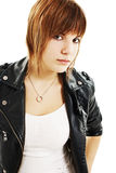 A young beautiful girl in a leather jacket royalty free stock photography