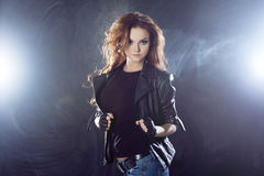 Young beautiful girl in a leather jacket on the Royalty Free Stock Photo
