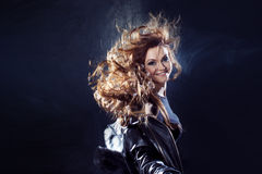 Young beautiful girl in a leather jacket on the Stock Images