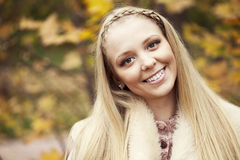 Young beautiful girl in a leather sheepskin coat Royalty Free Stock Images