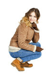 Young beautiful girl in a leather sheepskin coat and blue jeans Stock Photos