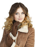 Young beautiful girl in a leather sheepskin coat Royalty Free Stock Image