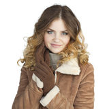 Young beautiful girl in a leather sheepskin coat Royalty Free Stock Photo