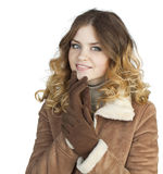 Young beautiful girl in a leather sheepskin coat Stock Photography