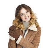 Young beautiful girl in a leather sheepskin coat Stock Photo