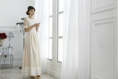 Young beautiful girl in a light long dress Royalty Free Stock Photo