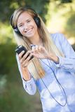 Young beautiful girl listening to mp3 stock photography