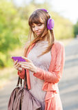 Young beautiful girl listening to MP3 player Stock Images