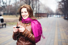 Young beautiful girl listening to MP3 player Stock Photography