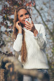 Young beautiful girl listening to music Stock Photography