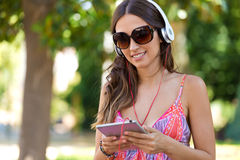 Young beautiful girl listening to music with digital tablet. Stock Photo