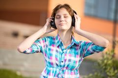 Young beautiful girl listening to music player on Stock Images