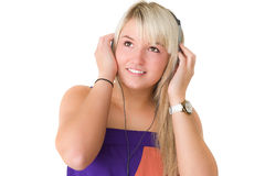 Young beautiful girl listening to musik Royalty Free Stock Photos