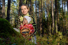 The young beautiful girl with the little daughter picking  bilberry Royalty Free Stock Images