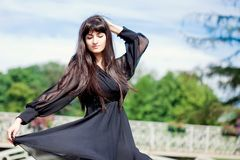 Young beautiful girl with long black hair Royalty Free Stock Photo