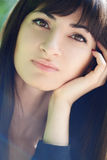 Young beautiful girl with long black hair Royalty Free Stock Image