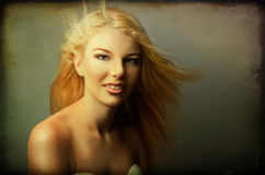 Young beautiful girl with long blond hair Stock Photo