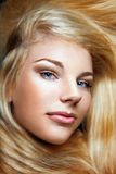 Young beautiful girl with long blond hair and styl Stock Images