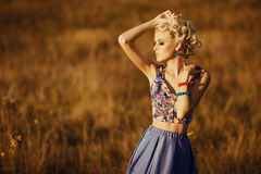 Young beautiful girl with long blond hear at field Stock Photography