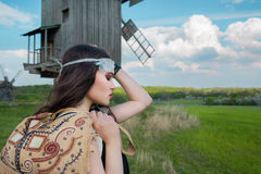 Young beautiful girl with long dark hair in green field Royalty Free Stock Image