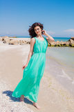 Young beautiful girl in a long dress on the beach in summer Royalty Free Stock Images