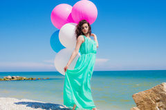 Young beautiful girl in a long dress on the beach in summer Royalty Free Stock Photos