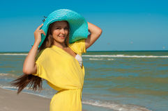 Young beautiful girl with long hair  at the beach Stock Photos