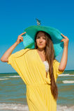 Young beautiful girl with long hair  at the beach Stock Images