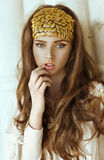 Young beautiful girl with long hair and gold fashion crown Royalty Free Stock Images