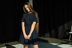 Young beautiful girl with long hair shy royalty free stock photography