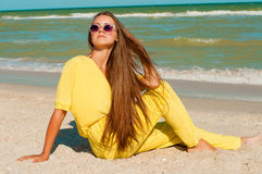 Young beautiful girl with long hair in swimsuit  at the beach Royalty Free Stock Image