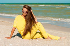 Young beautiful girl with long hair in swimsuit  at the beach Stock Images