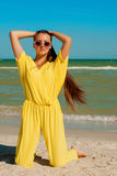 Young beautiful girl with long hair in swimsuit  at the beach Stock Image