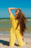 Young beautiful girl with long hair in swimsuit  at the beach Royalty Free Stock Photo