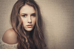 Young beautiful girl looking at camera, dramatic look stock photos