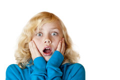 Young beautiful girl looks shocked into camera Royalty Free Stock Image