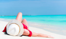 Young beautiful girl lying on the beach at shallow tropical water Royalty Free Stock Photography