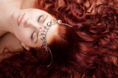 Young beautiful girl lying on the floor Royalty Free Stock Photography