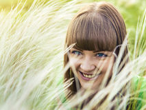 Young beautiful girl lying on the grass Royalty Free Stock Photography