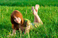Young beautiful girl lying on the grass Stock Photo