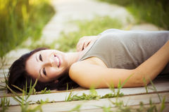 Lying on a walkway Royalty Free Stock Image