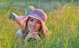 Young beautiful girl lying outdoor Stock Photo