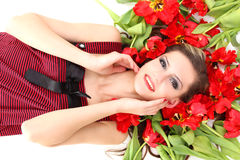 Young beautiful girl lying on the tulips Stock Image