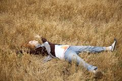 Young beautiful girl lying at yellow autumn field. Stock Photography