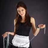 Young beautiful girl in maid costume with a chain Royalty Free Stock Photo
